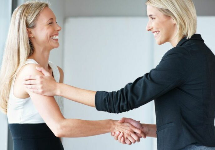 Women-Shaking-Hands
